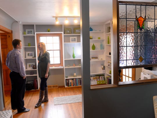 Roger and Bonnie Smith talk in their home in Williamstown Township just outside Williamston. The couple is moving to Grand Rapids and sold their home very quickly after receiving multiple offers when it was listed.