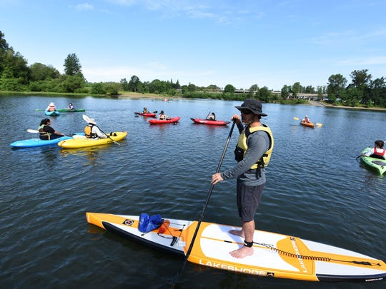 William White, Risk Manager for Salem-Keizer School District, helps supervise a group of Early College High School freshmen while they go kayaking on Friday, May 29, 2015, at Riverfront Park, as part of an event set up by the Straub Environmental Learning Center aimed at helping students feel comfortable in the water.