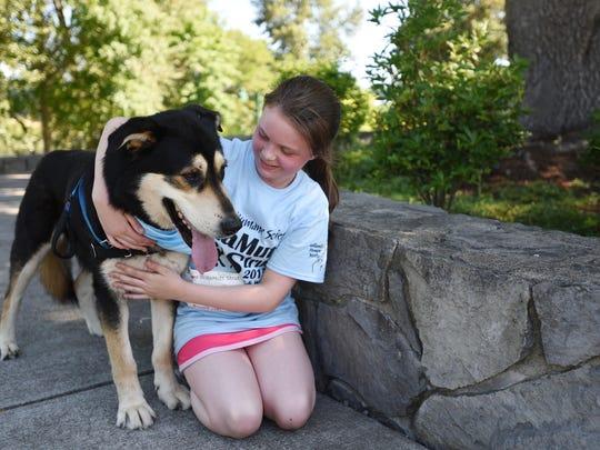Lara Halvorsen, 11, and her dog, Moose, participate in the WillaMutt Strut 5K Fun Run and Walk on Sunday, June 14, 2015, at Riverfront Park in Salem.