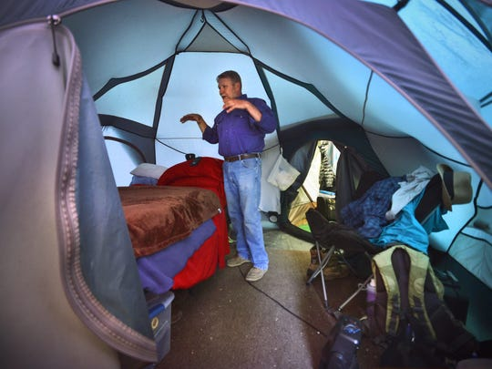 Jim Kubow shows his sleeping quarters on a tour of his base camp June 18 at Birch Lakes Campground. For tent campers, he said a vapor barrier is the most important component of a good night's sleep.
