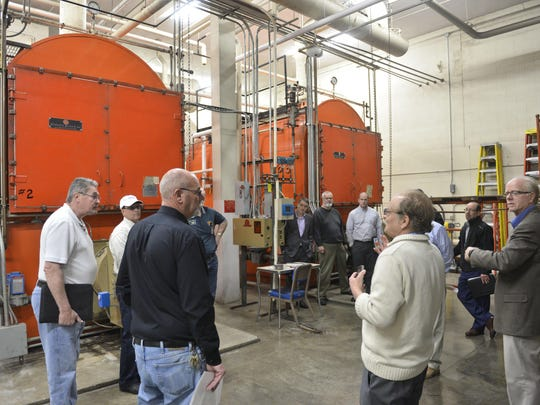 St. Cloud school board member Jerry Von Korff asks a question about the 1975 boilers inside Technical High School on April 21 during a tour with experts to help determine the costs associated with a renovation of the school.