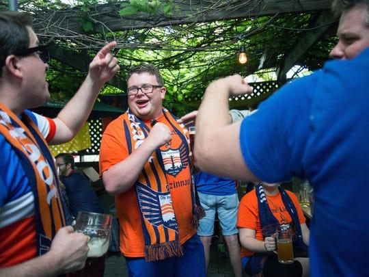 Members of Die Innenstadt cheer at Mecklenburg Gardens before the FC Cincinnati game against the Richmond Kickers.