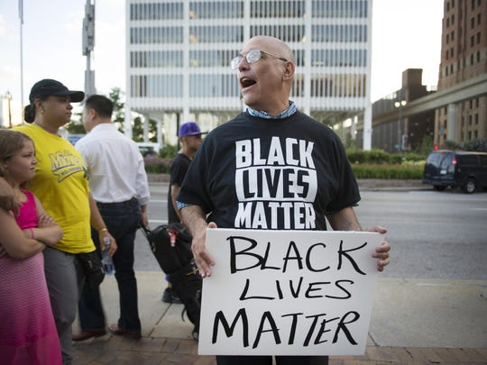 Jeffery Falick, Rabbi of the Birmingham temple, at the Black Lives Matter protest held in front of the Spirit of Detroit and marched toward Campus Martius, Monday July 25, 2016.