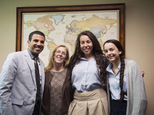 Omar Hakim, Jaquelin Riley, Jessica Goggins, 17, and Erin Brennan,15, pose for a photo after discussing experiences and expectations of the Global Scholars Program at Detroit Country Day School in Beverly Hills, on Monday, September 12, 2016.