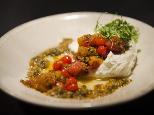 Zingerman's goat cheese and tomato dish is one of many dishes that are served with bruschetta.