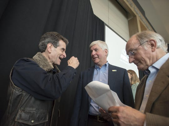 FIRST Robotics founder Dean Kamen, left, joins Gov. Rick Snyder and automotive executive Francois Castaing after a press conference at the North American International Auto Show celebrating the competition.
