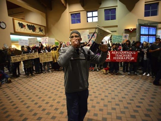 Shakir Farid Abdullah uses a megaphone Sunday during a protest at the Albuquerque Sunport. A group of 1,000 protesters took over the arrival and departure area to express their opposition to President Trump's executive order banning entry to the U.S to citizens from seven predominantly Muslim countries.