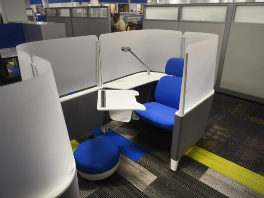 Left: The newly renovated space also includes individual work pods for employees to use.