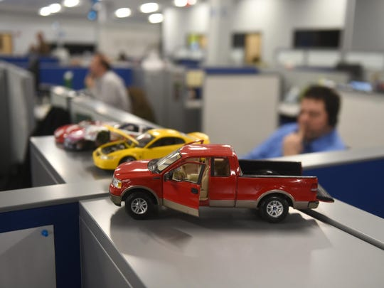 Above: Models of Ford vehicles decorate a work area at the automaker's offices.