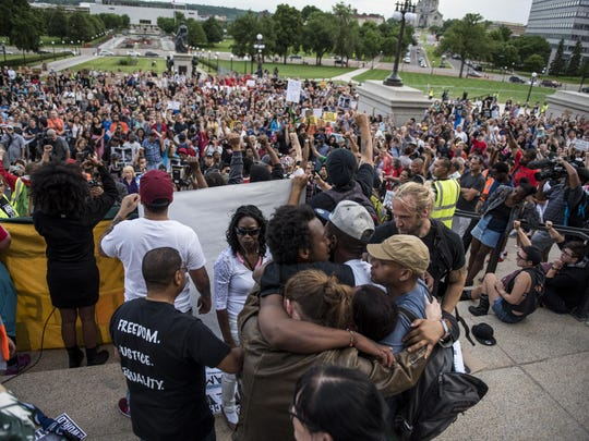 John Thompson, a friend and former colleague of Philando Castile, is embraced after speaking on the steps of the Minnesota State Capitol building on June 16, 2017 in St Paul, Minnesota. Protests erupted in Minnesota after Officer Jeronimo Yanez was acquitted on all counts in the shooting death of Philando Castile.