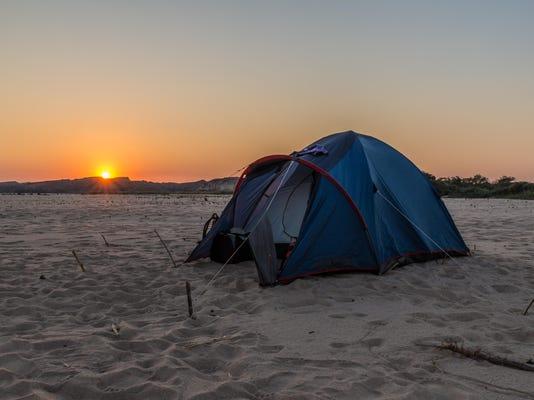 Campsite tent in river Manambolo