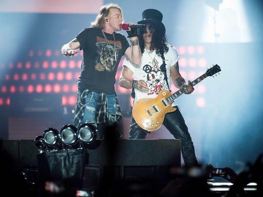 Axl Rose, left, lead singer of Guns N' Roses, performs with guitarist Slash.