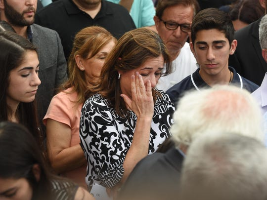 Nahrain Hamama gets emotional as she spoke about the deportation of her husband during a rally protesting the deportation of Iraqi-American immigrants at the McNamara Federal building in Detroit on Friday June 16, 2017.