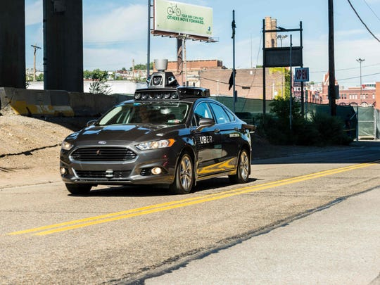 (FILES) In this file photo taken on September 13, 2016 a pilot model of an Uber self-driving car travels in Pittsburgh, Pennsylvania. Uber said on March 19, 2018, it is cooperating with police following a deadly accident involving one of the ride-share company's self-driving cars in Arizona. The Uber vehicle was in autonomous mode, with an operator behind the wheel, when it hit a woman walking in the street in the city of Tempe, according to the San Francisco-based company. / AFP PHOTO / Angelo MerendinoANGELO MERENDINO/AFP/Getty Images