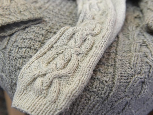 Brink-Chaney shows off her skills for knitting cables and other intricate stitch patterns with these sweaters, a cardigan and pullover, she made her husband.