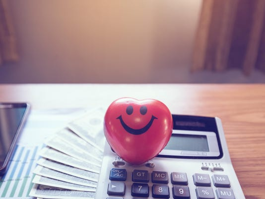 Heart-shaped smiley with money, calculator, mobile