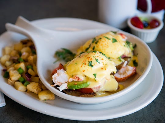 The lobster Benedict at Turning Point is made with lobster meat, smoked bacon, avocado, tomato and poached eggs topped with cilantro Hollandaise.