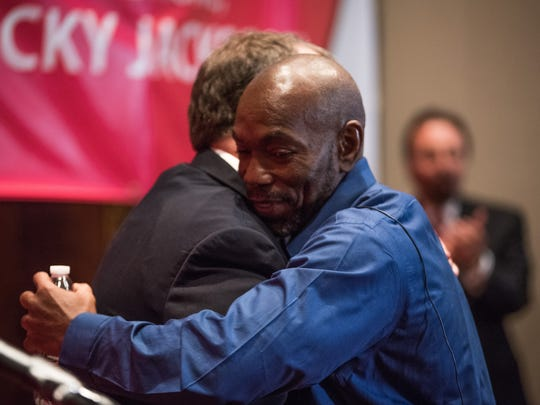 Ricky Jackson (right) and Mark Godsey, director of the University of Cincinnati's Ohio Innocence Project, embrace after Godsey's introduction of Jackson Tuesday at the University of Cincinnati. Jackson, the 18th person freed by the group, visited campus to thank those who made his exoneration possible.