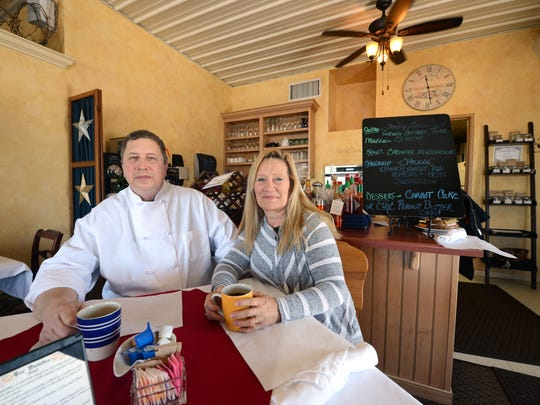 Chef and co-owner Ken Hendrickson, left, sits in the dining room of The Mustard Seed Cafe in Bellevue with his wife and co-owner Patty Hendrickson on Thursday. The Mustard Seed Cafe is expanding to a second location on Lineville Road in Suamico area.