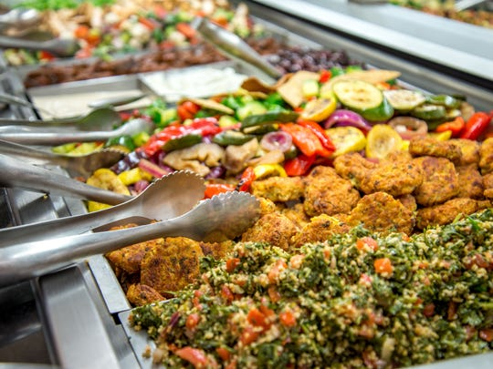 The Mezze bar at Kings Food Markets, Morristown, offers a variety of small dishes of Mediterranean influence, filled with chef-prepared ingredients.