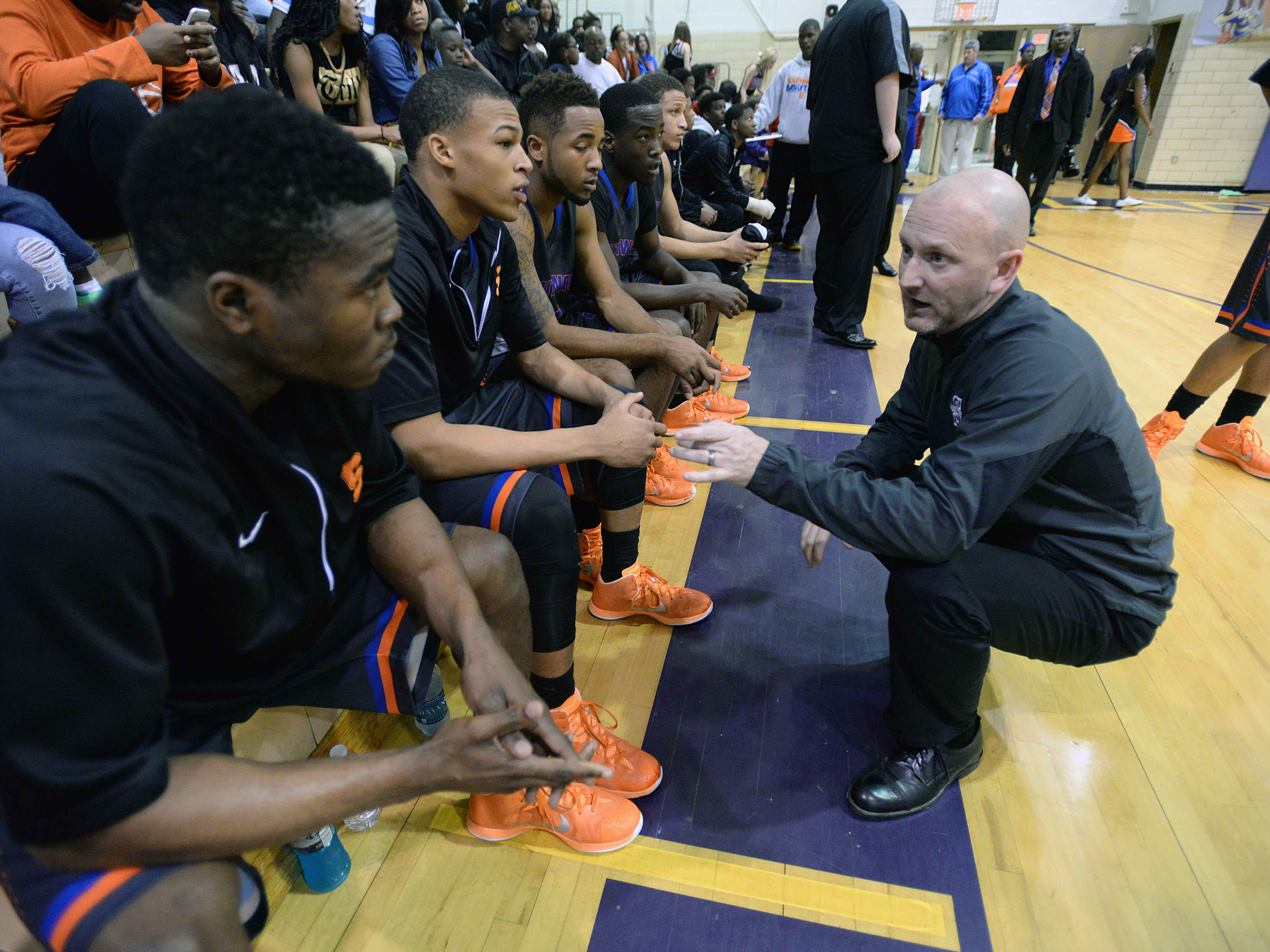 Southwood head coach Norm Picou has a word with his team as they take on Byrd Tuesday night.