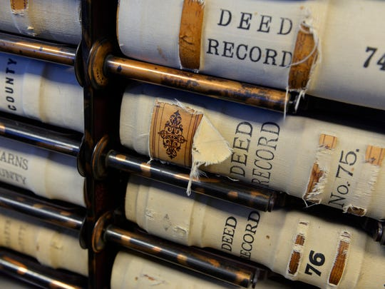 Some of the oldest books of records for Stearns County are fabric-covered, leather-bound editions.
