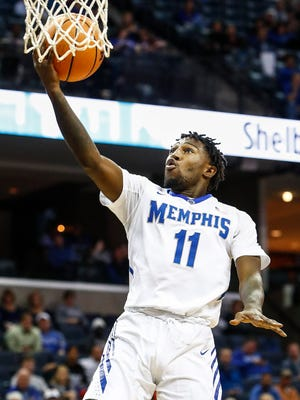Memphis guard Malik Rhodes drives for a layup against Little Rock on Tuesday.