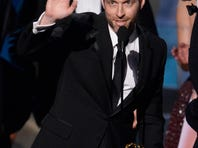 Host Andy Samberg prepares to present a coffee mug to Lorne Michaels at the 67th Primetime Emmy Awards on Sunday at the Microsoft Theater in Los Angeles.