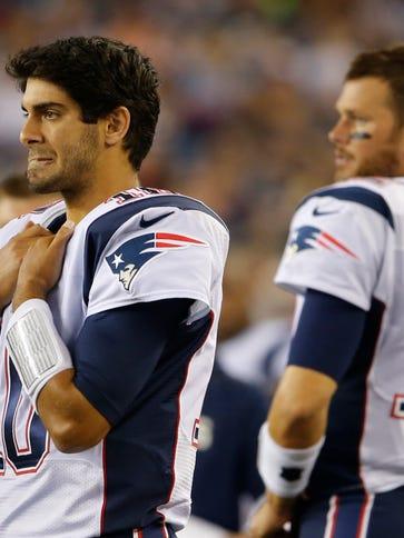 Patriots quarterbacks Jimmy Garoppolo, left, and Tom