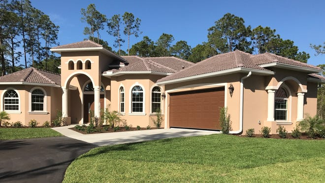 Nova Homes of South Florida has completed this custom home at 14025 Collier Blvd.