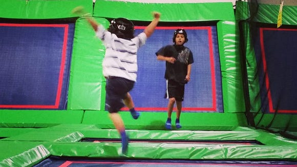 Oliver and Blake in the kids only section of the trampoline arena at Rebounderz