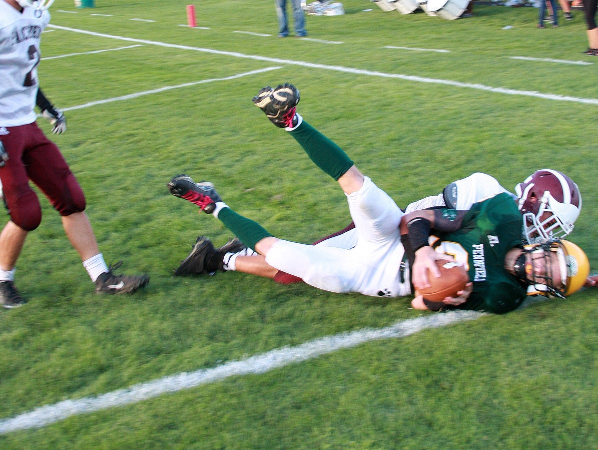 Pennfield junior Jaycob Herpin scores the first touchdown of the game