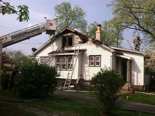 Firefighters are shown removing debris from a fire on the second floor of home on Fairfield Road in Cumberland Township.