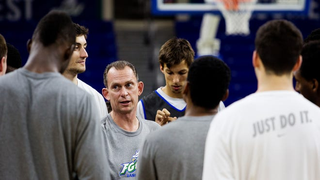 FGCU basketball coach Joe Dooley speaks with his team during a practice at Alico Arena on Monday 3/2/2015. The team is preparing for the Atlantic Sun Conference tournament quarterfinal.