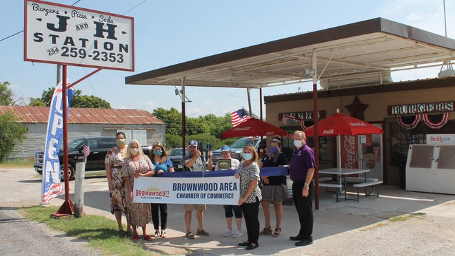 """The Brownwood Area Chamber of Commerce held a ribbon cutting July 8 for new member Sonny and LeAnn Garman with J and H Station. Sonny and LeAnn invite you to join them at J & H Station in May, They opened in 2014 offering  that hometown feel with great food and a connivance store.  Two favorites are tied between their good old fashioned burgers and great pizzas, particularly the """"Fully Loaded"""" and """"Meat Monster."""" Go by and see them at 19020 N. Hwy 183 in May or find them on Facebook at J&H Station Sonny and LeAnn Garman. Pictured are Owners Sonny and LeAnn Garman and ambassadors of the Brownwood Area Chamber of Commerce."""