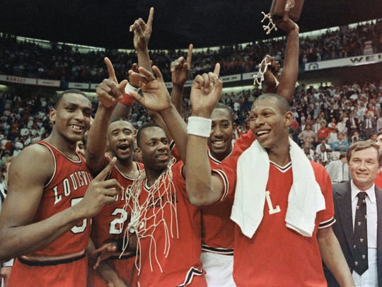 Louisville players celebrate after beating Duke in the 1986 NCAA title game. From left: Billy Thompson, Milt Wagner, Kevin Walls, David Robinson and Kenny Payne.