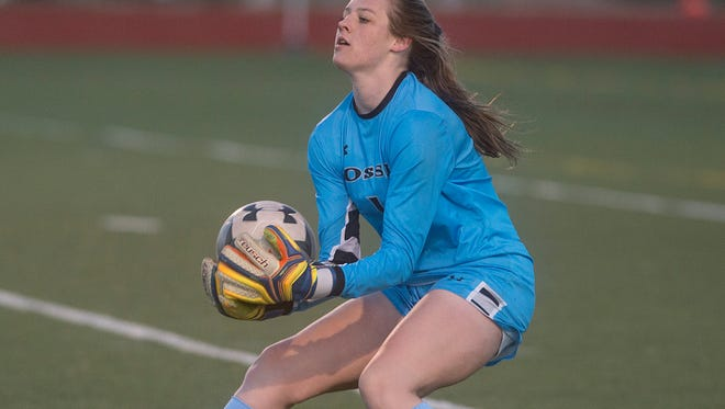 Fossil Ridge High School goalkeeper Vicky Graham catches the ball during a game against Rocky Mountain on Thursday, March 29, 2018.