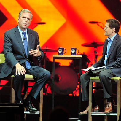 Jeb Bush, left, speaks with Russell Moore during a