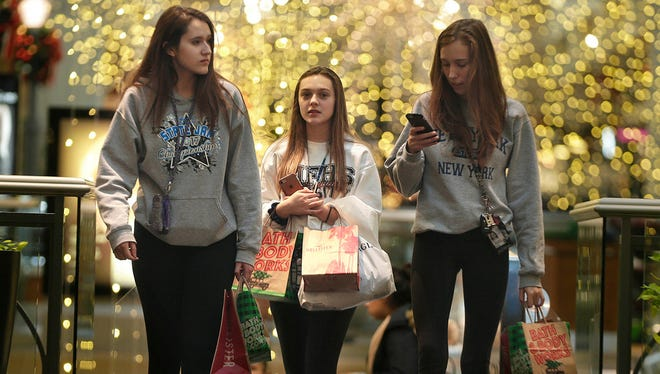 Hannah Klug (from left), Sierra Hoefs and Arianna Prange, all from Menomonee Falls, do some holiday shopping last month at Mayfair mall in Wauwatosa. Shoppers who wait until the last few days of this holiday shopping season to complete their gift buying should still be able to find some decent deals as retailers look to post a strong finish to what has been a generally good holiday season for them.