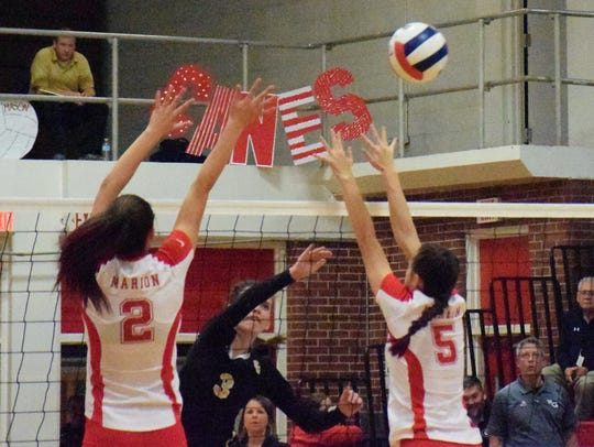 Buffalo Gap's Kaylee Mills puts the ball over Marion's