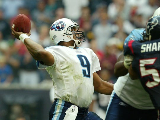 Titans quarterback Steve McNair passes to wide receiver Drew Bennett for a touchdown on fourth down to defeat the Texans 27-24 on Dec. 21, 2003, at Reliant Stadium.