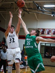 Ballinger's Chance Parker shoots as Wall's Zack Dusek tries to block Friday, Jan. 12, 2018, at Ballinger gym.