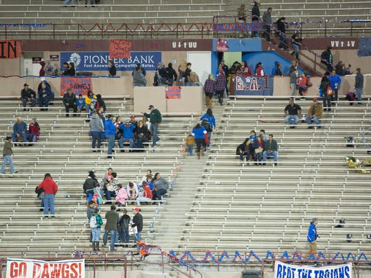 Las Cruces High School fans file out of Aggie Memorial Stadium, after game officials called a lighting delay, during the first quarter of the Las Cruces/Mayfield game on Friday. Friday's game was cancelled due to weather.