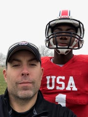Palmetto Ridge defensive coordinator P.J. Gibbs poses with Philip Dawson, a quarterback from Paramus (N.J.) Catholic, during practice for the Team USA 17 USA U17 Stars near Dallas, Texas, on Jan. 8. Gibbs coached the U.S. Stars last year, but this year will serve as head coach for Team Japan.