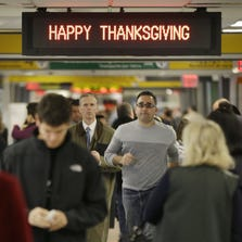 Travelers make their way through New York LaGuardia Airport on Nov. 26, 2013.