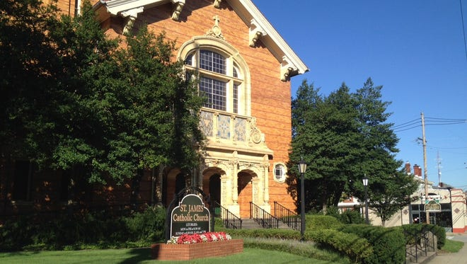 St. James Catholic Church, Edenside Avenue and Bardstown Road, reopened Friday after a vandalism attack.