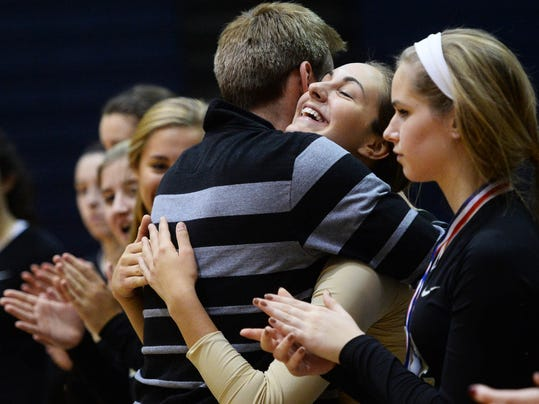 Delone Catholic's Kayla Baadte hugs head coach Jason Leppo after receiving her medal after the YAIAA girls' volleyball championship game at Dallastown Area High School Tuesday, October 21, 2014. Delone swept Red Lion to claim the title. (Photo bby Kate Penn - — GameTimePA.com)