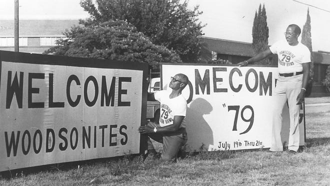 "Nelson Wilson, center, and Claudie Royals prepare signs to welcome ""Woodsonites"" to the first reunion in 1979. A reunion that begins Friday celebrates the 50th anniversary of the last graduating class of Rams."