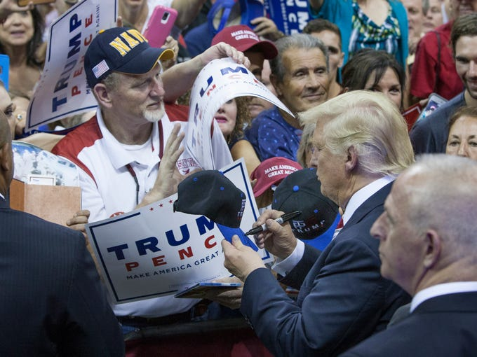 Donald Trump signs autographs and shakes hands at the