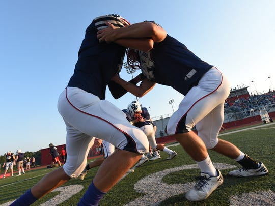 Two linemen go at it during the recent North DeSoto